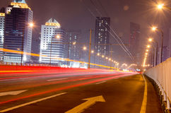 Moving cars with fast blurred trail of headlights Stock Image
