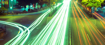 Moving cars with fast blurred trail of headlights Stock Photo