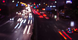 Moving cars with fast blurred trail of headlights Stock Photos
