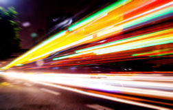 Moving cars with fast blurred trail of headlights Royalty Free Stock Image