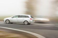 Moving cars on foggy weather in country road - Pol Royalty Free Stock Image