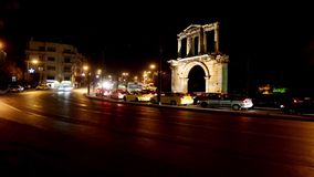 Moving cars under hadrian gate stock video footage