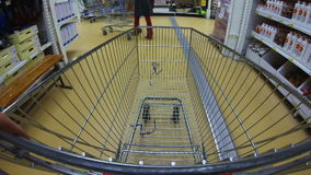 Moving cart in a supermarket stock footage