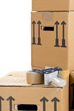 Moving carton boxes stack with tape roller Stock Image