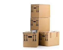 Moving carton boxes stack with tape roller Royalty Free Stock Image