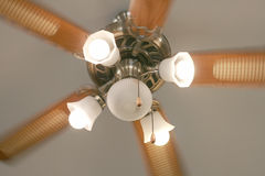 Moving ceiling fan with lamp in vintage style Stock Images