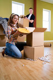Moving: Cheerful Couple Packing Household Items Stock Photos