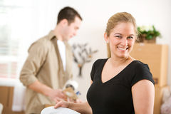 Moving: Cheerful Woman Packing Dishes Stock Photos