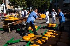 Moving cheese to cart at Alkmaar market Stock Photos