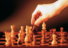 Moving chess pieces on a board Stock Photos