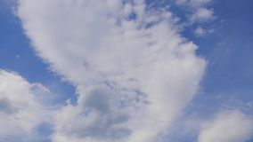 Moving clouds and blue sky.  stock video footage