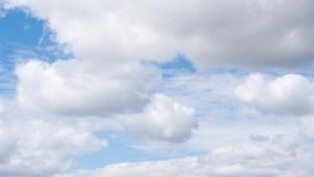 Moving clouds in the blue sky stock footage
