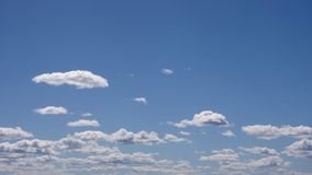 Moving clouds and blue sky stock footage