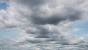 Moving clouds and blue sky. White clouds and blue sky, time lapse stock footage