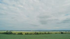 Moving clouds at green countryside. Time lapse.  stock footage