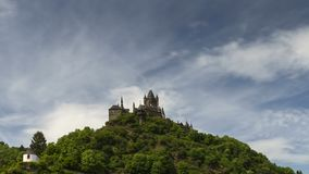 Moving clouds over castle Cochem stock video footage