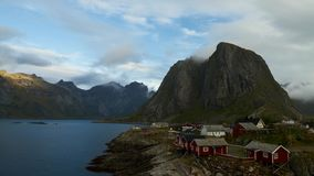 Moving clouds over the fishing village of Hamnoy stock video footage