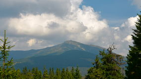 Moving clouds over the mountain peak. Carpathian mountains. stock footage