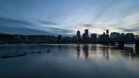 Moving Clouds over Portland OR downtown skyline at sunset 4k time lapse uhd. Moving clouds and blue sky over Portland OR downtown city skyline along Willamette stock footage