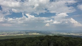 Moving clouds over the Wetterau as seen from viewpoint Winterstein stock footage