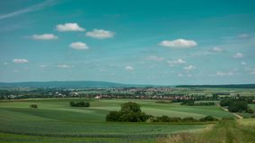 Moving clouds over a wheat field over the hillsape of the Wetterau stock footage