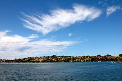 Moving Clouds. A splash of white paint across the clear blue sky Royalty Free Stock Images