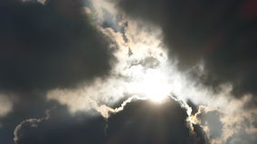 Moving clouds and sun stock footage