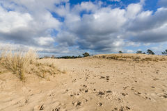 Moving Cloudy sky at a sandy dessert Stock Photo