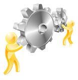 Moving cogs. Two men or mascot figures with giant machine cogs or gears Royalty Free Stock Photography
