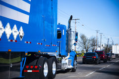 Moving in column blue big rig semi truck and trailer Royalty Free Stock Photos