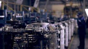 Moving Conveyer with engines. Worker making truck engines. Inductrial plant conveyor with engines. Worker assembling motors, engines stock footage