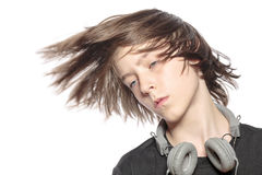 Moving cool teenager boy with headphones Royalty Free Stock Photos