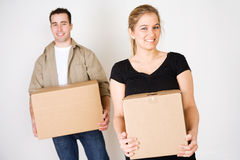 Moving: Couple Holding Packed Cardboard Boxes Royalty Free Stock Photography