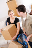 Moving: Couple Moving Boxes Out Of House Stock Images