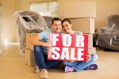 Moving couple for sale sign Stock Images