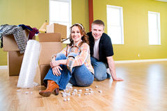 Moving: Couple Sitting Near Packing Supplies Stock Photo