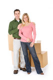 Moving: Couple with Stack of Moving Boxes Stock Image