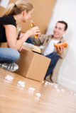 Moving: Couple Takes a Break From Packing With Sandwiches Stock Images