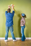 Moving: Couple Trying To Pick Paint Colors Royalty Free Stock Photo