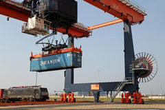 Moving crane with container Royalty Free Stock Photo