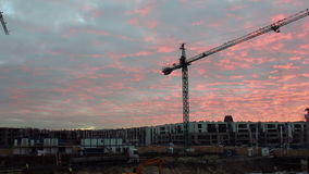 Moving Crane Under Sunset. Full HD time lapse of crane on construction, under beautiful sunset stock video footage
