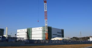 Moving cranes behind the blue sky at the under construction wide shot. Moving cranes behind the blue sky at the under construction. Niiza-shi Saitama Japan - 01 stock footage
