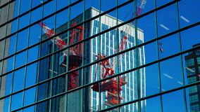 Moving cranes timelapse on the office building in Shinjuku Tokyo stock footage