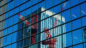Moving cranes timelapse on the office building in Shinjuku Tokyo stock video