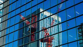 Moving cranes timelapse on the office building in Shinjuku Tokyo stock video footage