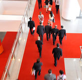 Moving crowd. In a international exhibition. motion blur royalty free stock photography