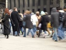 Moving Crowd. This is a blur shot of business people on their lunch hour in Rockefeller Center in Manhattan royalty free stock image