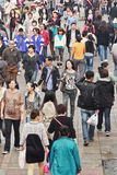 Moving crowd in Dalian, China. On October 14, 2012. China's estimated population is currently 1,338,612,968. 21% of the population are 14 years old or younger Royalty Free Stock Photo