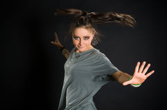 Moving dancer on black bacground. Young dancer jumps on a black background royalty free stock image