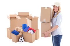 Moving day concept - attractive woman with brown cardboard boxes. With stuff isolated on white background Royalty Free Stock Photos